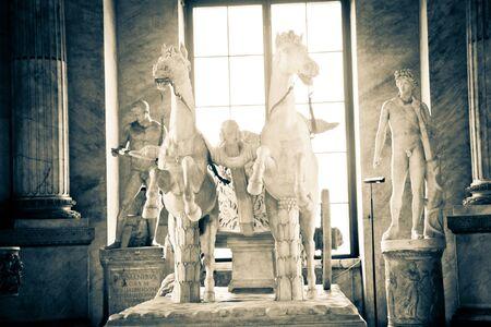 catholism: Statue of horses inside Vatican City Museum Editorial