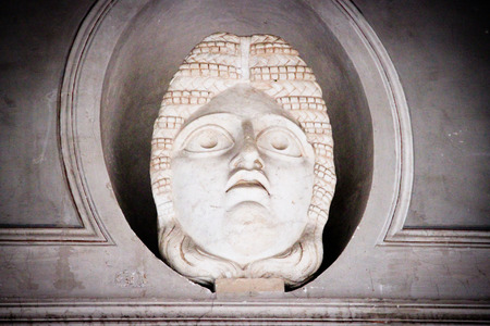 catholism: Statue of a head inside Vatican City Museum Editorial