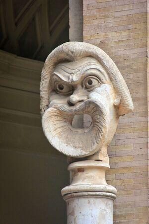 catholism: Statue of a screaming face inside Vatican City Museum