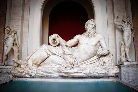 catholism: Statue of a lying man inside Vatican City Museum