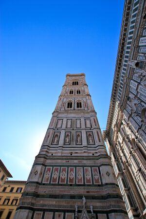catholism: Exterior of Basilica of Santa Maria Novella against the blue sky