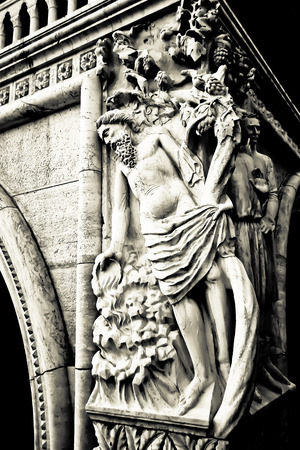 catholism: Statue at the base of a building