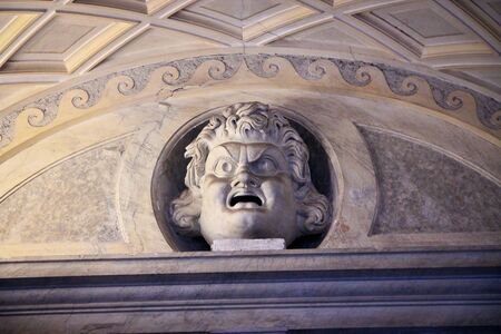 catholism: Statue of a angry face inside Vatican City Museum Editorial