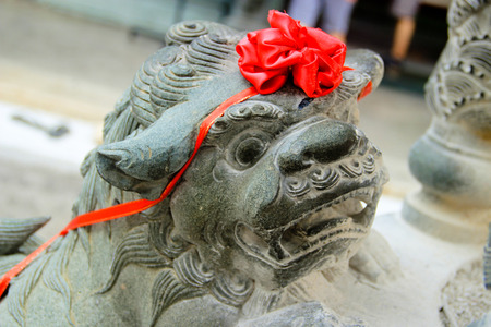stone lion: Stone Lion guarding the chinese temple in penang malaysia Stock Photo