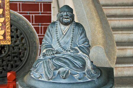 chinese buddha: Happy Stone chinese buddha statue  in a chinese temple