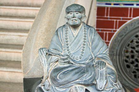chinese buddha: Stone chinese buddha statue  in a chinese temple Stock Photo
