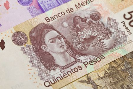 newest: New 500 peso mexican bill closeup showing Frida Kahlo the painter. This is the newest bill as of 2010 on the Mexican currency. Other bills above and below. Stock Photo