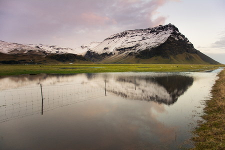 Majestic mountain peak with reflection on lake. Iceland