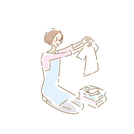 Cute housewife folding laundry