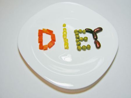 Diet word on the plate. Made from carrots corn peas and beans.