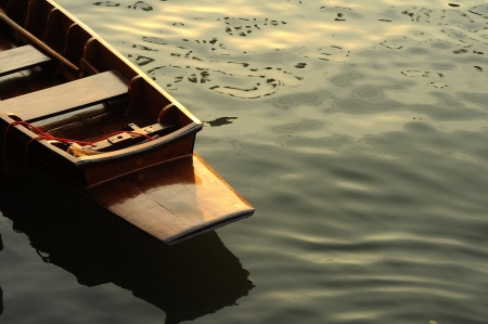 Rowboat float on the river with sunset ray