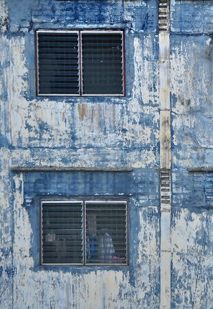 Vintage wall and blue window  Stock Photo