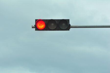 red traffic light in front of blue sky Stock Photo