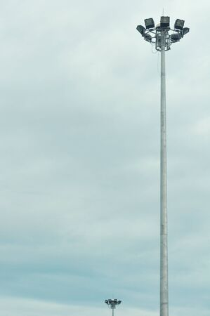 Ground light pole on cloudy sky background Stock Photo