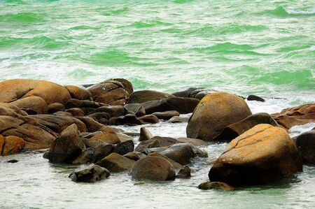 Wide angle of wild beach with rocks in water,Rayong Thailand photo