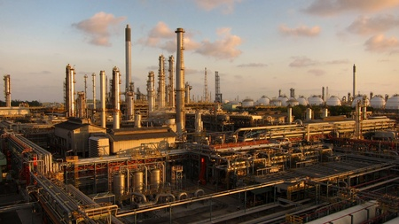 Oil and gas refinery at twilight - Petrochemical Industry