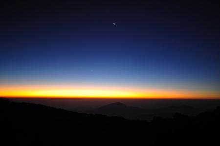 Beautiful Sunrise over a Silhouetted Horizon Stock Photo