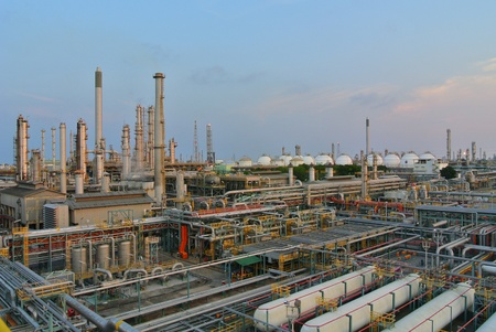 Oil and gas refinery at twilight - Petrochemical factory Editorial