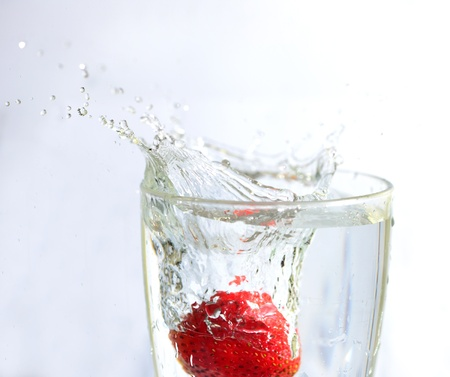 Strawberry in mood of water splash photo