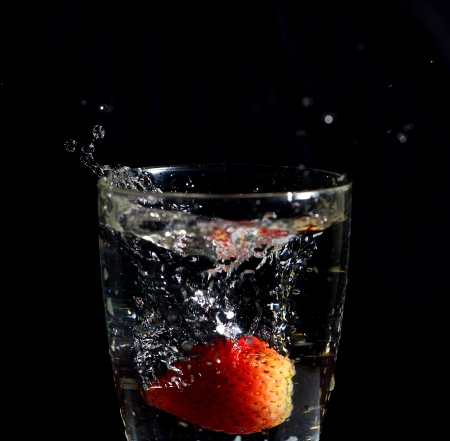 Strawberry in mood of water splash photo