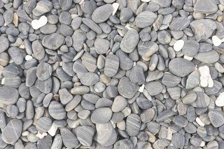 nice shot of wet pebble stone on the beach photo