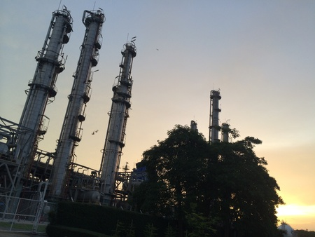 Oil and gas plant with sun set background