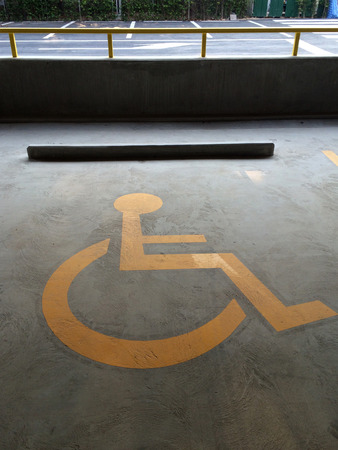 symbolization: Handicapped Symbol Painted on a Parking Spot