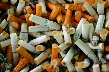 ashtray: Ashtray full of cigarettes