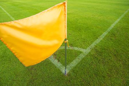 Yellow flag in corner of football playground