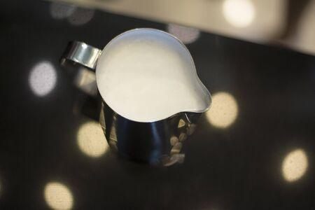 cappucino: Fresh milk prepare for cappucino coffee Stock Photo