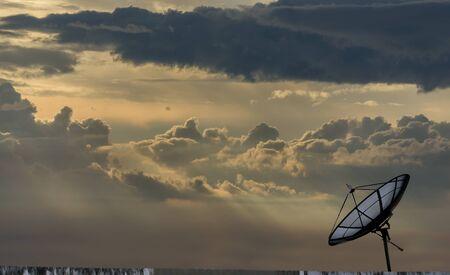 transmit: Single Satellite dish stand with beautiful sky