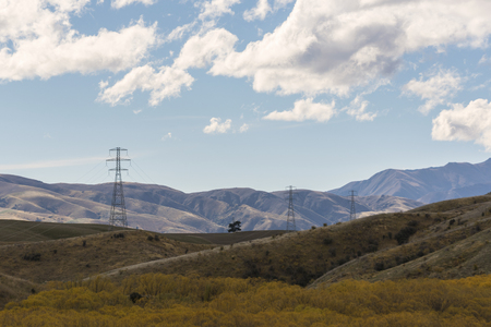 High voltage electric pols in mountain range