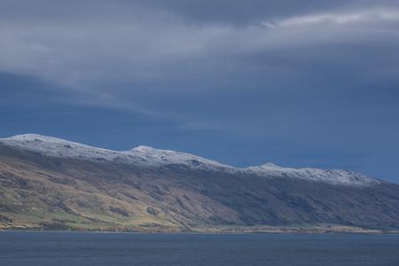Non urban grassland aginst snow mountain at New Zealand Stock Photo