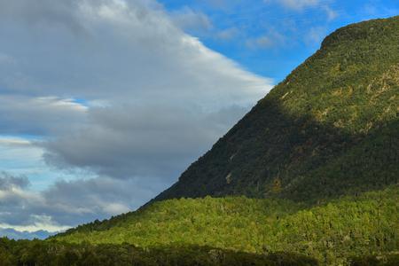 Beautiful green mountain against blue sky