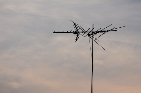Telecommunication pole with sky at dawn Stock Photo