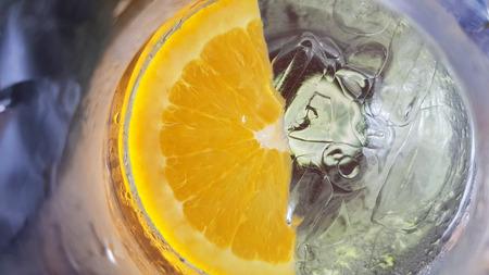 Fresh lemon dropped in cool drink water