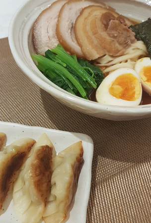 Janpanese noodle ramen with pork gyoza