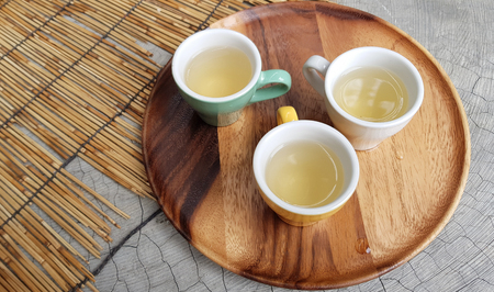 Little yellow cup of white tea Stock Photo
