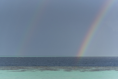 Double rainbow with pearl sea at Maldives Stock Photo