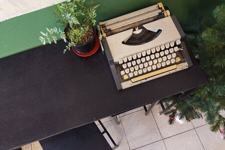 Vintage retro classic typewriter in cafe against wooden table