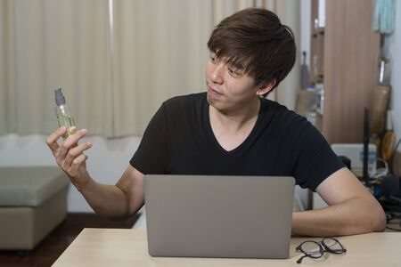 Asian officer man work from home. Man work in action at home. Man with laptop working remotely via high speed internet connection. Communication technology meeting from home.