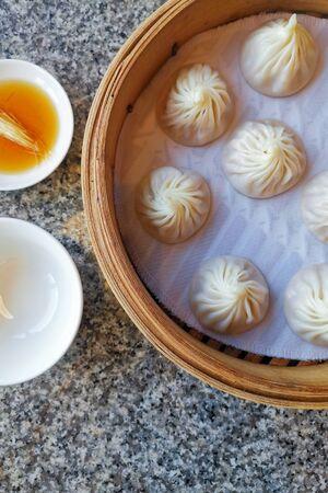 Chinese dumpling xiao long bao serve on bamboo box on chinese restaurant.