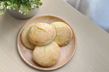Baked english scone serve for coffee break on wooden dish