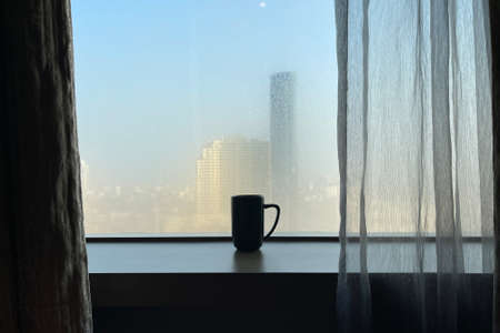 Glass shape of coffee cup with foggy window theme with morning light