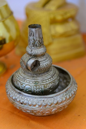 silver jug for pour ceremonial water, Buddhist rituals  photo