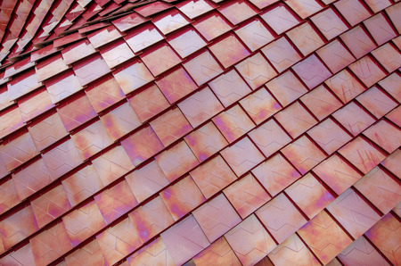 Red metalized roof tiles background Stock Photo