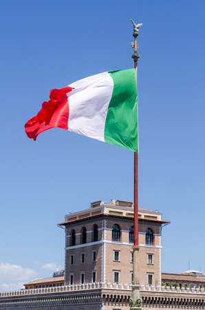 parliamentary: Italian flag blowing in the wind. Stock Photo