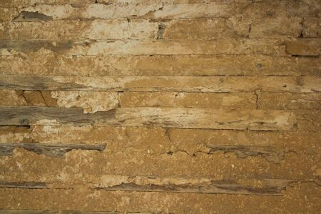 Old wooden wall with insulation made of clay. Vintage background.