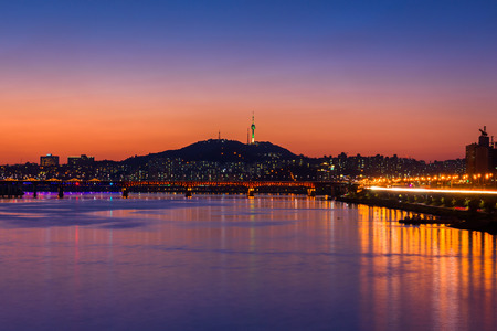 river view: Sunset of Seoul City and Bridge at Hanriver in Seoul, South korea