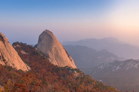 red mountain: sunrise of Baegundae peak, Autumn Season at Bukhansan mountains in Seoul, South Korea